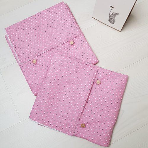 tapis à langer replié couleur rose
